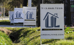 """FILE - In this Tuesday, Feb. 16, 2016, file photo, """"For Sale"""" signs are stacked up outside a new complex of townhouses in Houston. On Thursday, Dec. 1, 2016, Freddie Mac reports on the week's average U.S. mortgage rates. (AP Photo/Pat Sullivan, File)"""