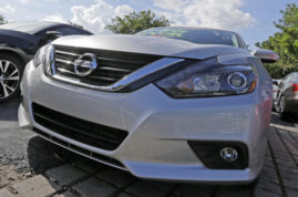 This Tuesday, June 28, 2016, photo, shows the front of a 2016 Nissan Altima at a Nissan dealer, in Miami. Black Friday deals were expected to pull U.S. auto sales out of their recent slump in November 2016. General Motors' sales jumped 10 percent over last November, while Toyota's sales were up 4 percent. Nissan's sales rose 7.5 percent. (AP Photo/Alan Diaz)