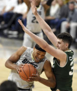 Colorado's George King drives into Colorado State's Nico Caravacho during the second half of an NCAA college basketball game Wednesday, Nov. 30, 2016, in Boulder, Colo. (Cliff Grassmick/Daily Camera via AP)