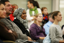 Farduus Ahmed, a Somalian refugee, listens to a panel discussion concerning immigrant policies, rights and mental health on Thursday Dec. 01, 2016 at Aurora Central High School. Photo by Gabriel Christus/Aurora Sentinel