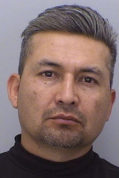This undated photo provided by Douglas County Sheriff's Office shows Noe Gamez-Ruiz, who was charged with careless driving resulting in the death of Trooper Cody Donahue and failure to yield the right-of-way to an emergency vehicle. The trooper died Friday, Nov. 25, 2016, after he was struck by a commercial vehicle while investigating a traffic crash on the interstate south of Castle Rock, Colo.  (Douglas County Sheriff's Office via AP)