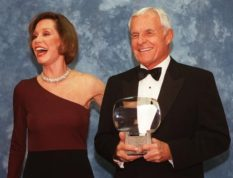 "FILE - In this Saturday, Nov. 1, 1997, file photo, Television executive Grant Tinker holds up his Hall of Fame award alongside his ex-wife Mary Tyler Moore at the Academy of Television Arts & Sciences' 13th Annual Hall of Fame induction ceremonies in the North Hollywood section of Los Angeles. Tinker, who brought ""The Mary Tyler Moore Show"" and other hits to the screen as a producer and a network boss, has died. Tinker died Monday, Nov. 28, 2016, at his home in Los Angeles, according to his son, Mark Tinker. (AP Photo/Chris Pizzello, File)"