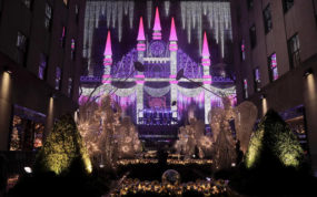 Christmas angels frame the side of the Saks Fifth Avenue store which was aglow with lights across from Rockefeller Center during the 84th annual Rockefeller Center Christmas tree lighting ceremony, Wednesday, Nov. 30, 2016, in New York. The 94-foot tall Norway spruce is covered with 50,000 multicolored LED lights. (AP Photo/Julie Jacobson)