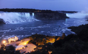 FILE - In this July 22, 2013, file photo, the Canadian side of the American Falls and Horseshoe Falls are illuminated in blue to celebrate the birth of the Duke and Duchess of Cambridge's son in Niagara Falls, Ontario, Canada. Officials say new energy-efficient LED lighting being unveiled Thursday, Dec. 1, 2016, will provide brighter and more robust color than the halogen technology that's been used to cast the Falls in rainbow hues for the past 20 years. (AP Photo/Gary Wiepert, File)