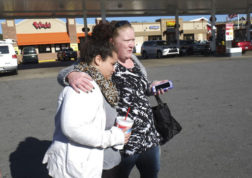 Karyssa Dalton, left, is comforted by her friend, Christina Wilpers, during a search for Dalton's missing grandmother Thursday, Dec. 1, 2016, in Pigeon Forge, Tenn. Pamela Johnson, 59, who resided at the Travelers Motel on U.S. 321, hasn't been heard from since a wildfire burned through Gatlinburg this week. (Paul Efird/Knoxville News Sentinel via AP)