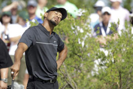 Tiger Woods stretches before teeing off on the first hole during the first round at the Hero World Challenge golf tournament, Thursday, Dec. 1, 2016, in Nassau, Bahamas. (AP Photo/Lynne Sladky)
