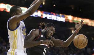 Houston Rockets' Montrezl Harrell (5) loses the ball as Golden State Warriors' Kevin Durant, left, defends during the first half of an NBA basketball game Thursday, Dec. 1, 2016, in Oakland, Calif. (AP Photo/Ben Margot)