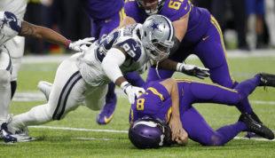 Dallas Cowboys defensive tackle Cedric Thornton, left, sacks Minnesota Vikings quarterback Sam Bradford (8) during the second half of an NFL football game Thursday, Dec. 1, 2016, in Minneapolis. (AP Photo/Andy Clayton-King)