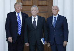 President-elect Donald Trump and Vice President-elect Mike Pence pose for photographes with retired Marine Corps Gen. James Mattis as he arrives at Trump National Golf Club Bedminster clubhouse in Bedminster, N.J., Saturday, Nov. 19, 2016. (AP Photo/Carolyn Kaster)