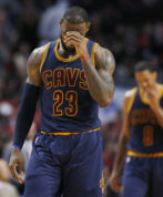 Cleveland Cavaliers forward LeBron James wipes his face as he looks down after guard Kyrie Irving missed a shot during the second half of the team's NBA basketball game against the Chicago Bulls on Friday, Dec. 2, 2016, in Chicago. The Bulls won 111-105. (AP Photo/Nam Y. Huh)