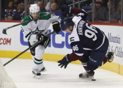 Colorado Avalanche right wing Mikko Rantanen, right, of Finland, tumbles while trying to pick up a loose puck as Dallas Stars defenseman John Klingberg, of Sweden, defends during the third period of an NHL hockey game Saturday, Dec. 3, 2016, in Denver. Dallas won 3-0. (AP Photo/David Zalubowski)