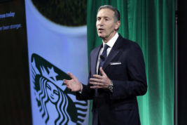 Starbucks Chairman and CEO Howard Schultz presents during the Starbucks 2016 Investor Day meeting, in New York, Wednesday, Dec. 7, 2016. (AP Photo/Richard Drew)