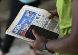 FILE - In this Tuesday, July 19, 2016, file photo, a job applicant attends a job fair in Miami Lakes, Fla. On Wednesday, Dec. 7, 2016, the Labor Department reports on job openings and labor turnover for October. (AP Photo/Lynne Sladky, File)