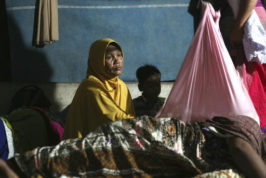 Earthquake survivors spend a night at a temporary shelter in Ulim, Aceh province, Indonesia, Thursday, Dec. 8, 2016. Thousands of people in the Indonesian province of Aceh took refuge for the night in mosques and temporary shelters after a strong earthquake on Wednesday killed a large number of people and destroyed dozens of buildings. (AP Photo/Binsar Bakkara)
