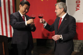 FILE - In this Feb. 15, 2012 file-pool photo, Chinese Vice President Xi Jinping and Iowa Gov. Terry Branstad raise their glasses at the beginning of a formal dinner in the rotunda at the Iowa Statehouse in Des Moines, Iowa. Branstad, President-elect Donald Trump's choice for U.S. ambassador to China, can boast a 30-year relationship with Chinese President Xi Jinping, the most powerful Chinese leader in decades, especially amid escalating talk of a trade war with the U.S.'s largest trading partner?  (AP Photo/The Des Moines Register, Andrea Melendez, Pool, File)