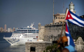 FILE - In this May 2, 2016 file photo, Carnival's Fathom cruise line ship Adonia arrives from Miami in Havana, Cuba. On Wednesday, Dec. 7, Royal Caribbean and Norwegian cruises announced that they had received permission from the Cuban government to begin sailing from the U.S. to Cuba. Norwegian Cruise Line Holdings plans sailings on ships from two of its brands, Norwegian Cruise Line and Oceania. Royal Caribbean will also sail on two lines, Royal Caribbean International and Azamara Club Cruises. (AP Photo/Ramon Espinosa, File)