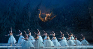 "Performers dance during the ""snow scene"" of Colorado Ballet's ""The Nutcracker,"" now showing at Ellie Caulkins Opera House in Denver. Photo courtesy of Mike Watson"