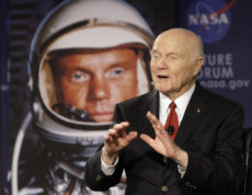 """FILE - In this Feb. 20, 2012, file photo, U.S. Sen. John Glenn talks with astronauts on the International Space Station via satellite before a discussion titled """"Learning from the Past to Innovate for the Future"""" in Columbus, Ohio. Glenn, who was the first U.S. astronaut to orbit Earth and later spent 24 years representing Ohio in the Senate, has died at 95. (AP Photo/Jay LaPrete, File)"""