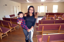In this Dec. 8, 2016 photo, Ingrid Encalada Latorre walks with her year-old son, Anibal, where she is taking sanctuary at a Denver Quaker center, the Mountain View Friends Meeting, a small, two-story brick structure just blocks from the University of Denver, in Denver. Latorre has exhausted all appeals of a deportation order to her native Peru and is awaiting a decision on a final, discretional appeal to immigration officials in Washington. Hundreds of houses of worship are offering sanctuary to people who fear deportation under the administration of President-elect Donald Trump. (AP Photo/P. Solomon Banda)