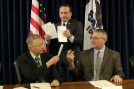 Iowa Sec. of State Paul Pate, center, collects ballots from Iowa electors Alan Braun, of Norwalk, Iowa, left, and Don Kass, of Remsen, Iowa, right, during Iowa's Electoral College vote, Monday, Dec. 19, 2016, at the Statehouse in Des Moines, Iowa. Iowa's six voters cast their ballots for Republican Donald Trump. (AP Photo/Charlie Neibergall)