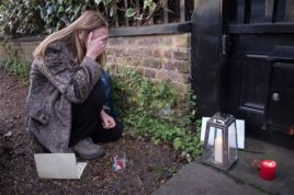 A George Michael fan  reacts outside Michael's  London home, Monday Dec. 26, 2016.  George Michael, the British pop superstar who reached early fame with WHAM! and went on to a solo career lined with controversies and chart-topping hits that blended soul and dance music with daring social and personal commentary, has died, his publicist said Sunday. He was 53.  (Stefan Rousseau/PA via AP)