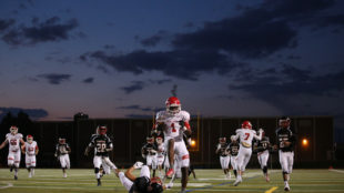 Regis Jesuit High School junior DJ Jackson scores a touchdown against Rangeview High School on Friday Sept. 16, 2016 at Aurora Public Schools Stadium. Regis beat Rangeview 34-18.  Photo by Gabriel Christus/Aurora Sentinel