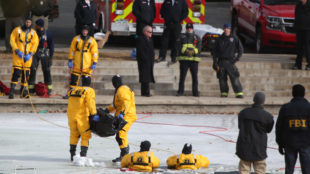 Rescue crews carry what was believed to be the body of 6-year-old David Puckett out of the water Jan. 3 at Olympic Park. Photo by Gabriel Christus/Aurora Sentinel
