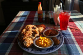 "Owner of Cora Faye's Café in Aurora, Priscilla Smith, said customers come for ""fried chicken to taste like fried chicken."" Pictured here Dec. 29 is the fried chicken meal with yams, macaroni and cheese and the restaurant's signature red Kool-Aid. Photo by Gabriel Christus/Aurora Sentinel"