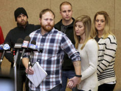 Family spokesman David Boyd and others hold a news conference Thursday, Jan. 5, 2017, in Crystal Lake, Ill., after an 18-year-old man was assaulted in Chicago earlier this week. Four people were charged with hate crimes Thursday in connection with a video broadcast live on Facebook that showed a mentally disabled white man being beaten and taunted, threatened with a knife and forced to drink from a toilet. Boyd is the brother-in-law of the victim. (Patrick Kunzer/Daily Herald via AP)