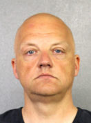 This photo provided by the Broward County Sheriff's Office shows Oliver Schmidt under arrest on Jan. 7, 2017. Schmidt, the general manager of the engineering and environmental office for Volkswagen America, was arrested in connection with the company's emissions-cheating scandal. He has an appearance in Miami Federal Court, Monday, Jan. 9, 2017. (Broward County Sheriff's Office via AP)