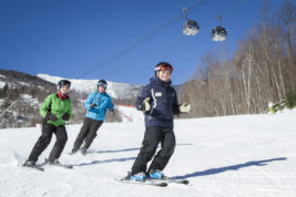This Jan. 14, 2015 photo provided by ORDA/Whiteface Lake Placid, shows Megan Gardner, right, as she teaches participants in a lesson at Whiteface Mountain in Wilmington, N.Y., near Lake Placid. Whiteface, like other ski resorts, is creating programs to attract younger skiers as a way of maintaining interest in the sport as baby boomers age out. (ORDA/Whiteface Lake Placid via AP)