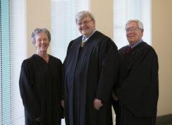 Loretta Huffine, Gregory Hopkins, and Alan Stien on Friday Dec. 30, 2016 at Aurora District court. Photo by Gabriel Christus/Aurora Sentinel