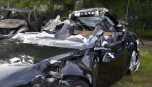 FILE - In this photo provided by the National Transportation Safety Board via the Florida Highway Patrol, a Tesla Model S that was being driven by Joshua Brown, who was killed when the Tesla sedan crashed while in self-driving mode on May 7, 2016. A source tells The Associated Press that U.S. safety regulators are ending an investigation into a fatal crash involving electric car maker Tesla Motors' Autopilot system without a recall. The National Highway Traffic Safety Administration scheduled a call Thursday, Jan. 19, 2017, about the investigation. (NTSB via Florida Highway Patrol via AP, File)