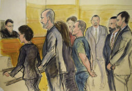 """In this courtroom drawing, Joaquin """"El Chapo"""" Guzman, center, appears in a New York courtroom on Friday, Jan. 20, 2017, after being extradited by Mexico to face federal drug trafficking and other charges. Guzman entered a not-guilty plea through his court-appointed lawyer and will be held without bail in a jail that has handled terror suspects and mobsters. From left are, Federal Judge James Orenstein; Assistant US Attorney Patricia Notopoulos; Federal Defender Michael Schneider, Federal Defender Michelle Gelernt, partially obscured; and the defendant. The three men at rear are Deputy U.S. Marshals.  (Elizabeth Williams via AP)"""