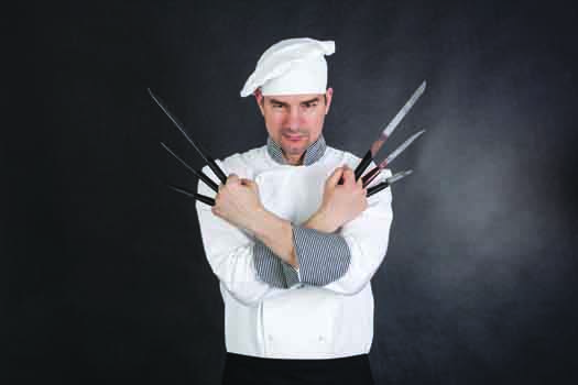 Chef with knifes arms crossed