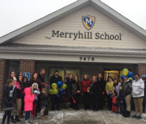 Students, parents, teachers and administrators gather for a ribbon-cutting and grand opening ceremony Jan. 4 at the new Merryhill Preschool. Courtesy photo