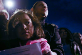 Anabelle Torres and grandmother Silvia Torres stand together at the Love Knows no Bans no Walls Vigil on Monday Feb. 06, 2017 at the ICE Detention Center. Silvia's son has been in the center for eight months.  Photo by McKenzie Lange/Aurora Sentinel