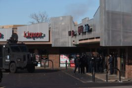 Aurora Police at the site of a standoff with an armed suspect Wednesday morning Feb. 15, 2017 at a shopping strip mall at 3095 S. Peoria Street. The suspect had barricaded himself in one of the businesses. Police said the incident was related to domestic violence charges. PHOTO BY GABRIEL CHRISTUS/Aurora Sentinel