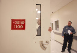 An Adams County deputy opens the door of a direct supervision housing unit Oct. 31 at Adams County Jail in Brighton. (Heather L. Smith/Aurora Sentinel)