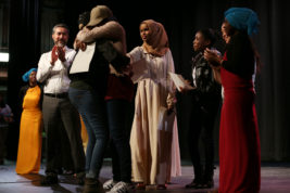 Urji Nohamed and Fanny Farhat embrace on stage after they won first place at the International City Talent Show on Friday Feb. 10, 2017 at Aurora Central High School. Photo by McKenzie Lange/Aurora Sentinel