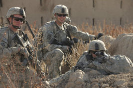 """In this undated photo provided by Regis University, Nathaniel Pryor, left, is shown with other American soldiers on patrol in Kandahar, Afghanistan. Pryor has joined with other soldiers to participate in a panel series of talks taking place through April 2017 called """"Stories From Wartime,"""" at Regis University in northwest Denver. (Nathaniel Pryor/Regis University via AP)"""
