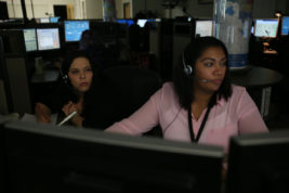 Sara Warwick (left) guides trainee Leah Jackson through 911 calls on Friday Feb. 17, 2017 at the City of Aurora Public Safety Communications Center. Photo by McKenzie Lange/Aurora Sentinel