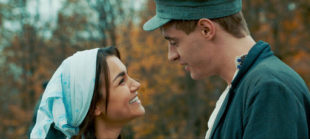 "This image released by Roadside Attractions shows Samantha Barks, left, and Max Irons in a scene from, ""Bitter Harvest."" (Roadside Attractions via AP)"