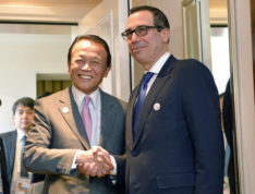 Japanese Finance Minister Taro Aso, left, and U.S. Treasury Secretary Steven Mnuchin meet for talks ahead of the G-20 Finance Ministers meeting in Baden-Baden, southern Germany, Friday, March 17, 2017. (Franziska Kraufmann/dpa via AP)