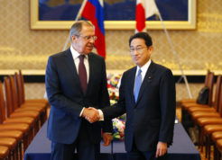 """Russian Foreign Minister Sergei Lavrov, left, shakes hands with Japanese Foreign Minister Fumio Kishida at the start of their meeting as a part of Japan-Russia foreign and defence ministers meeting at Iikura guest house in Tokyo, Japan Monday, March 20, 2017.  The foreign and defense ministers from Japan and Russia are meeting in Tokyo for the first """"two-plus-two"""" talks since Russia's annexation of Ukraine. (Issei Kato/Pool Photo via AP)"""