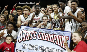 The Eaglecrest Raptors pose as a group with their new 5A State Championship trophy March 11 at the Denver Coliseum. Eaglecrest overcame a six-point deficit at the end of the first half defeating George Washington 53-47. (Photo by Philip B. Poston/Aurora Sentinel)