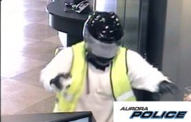 A man wearing a motorcycle helmet and bright safety vest jumped on a counter at a southeast Aurora bank Thursday morning, demanded cash and fled the scene with an undisclosed amount of money, police said.  The robbery happened around 9:15 a.m. at the BBVA Compass Bank at 22795 E. Aurora Parkway