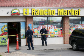 Aurora Police officers stand outside of the El Rancho Market on Thursday, where Federal agents broke up a drug ring that was operating out of the grocery store. Photo by Gabriel Christus/Aurora Sentinel