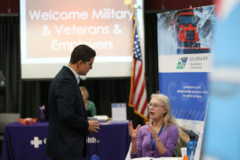 David Medina, who served in the Air Force from 1999-2003, talks with Lynn Livingston with the Colorado Department of Transportation during a Military and Veterans Employment Expo on Friday April 14, 2017 at Community College of Aurora. Photo by Gabriel Christus/Aurora Sentinel