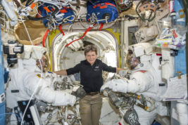 FILE - In this Jan. 13, 2017 file photo made available by NASA, astronaut Peggy Whitson, center, floats inside the Quest airlock of the International Space Station with Thomas Pesquet, left, and Shane Kimbrough before their spacewalk. Early Monday, April 24, 2017, the International Space Station commander surpassed the 534-day, two-hour-and-48-minute record set last year by Jeffrey Williams for most accumulated time in orbit by an American.  Whitson already was the world's most experienced spacewoman and female spacewalker and, at age 57, the oldest woman ever in space. (NASA via AP, File)
